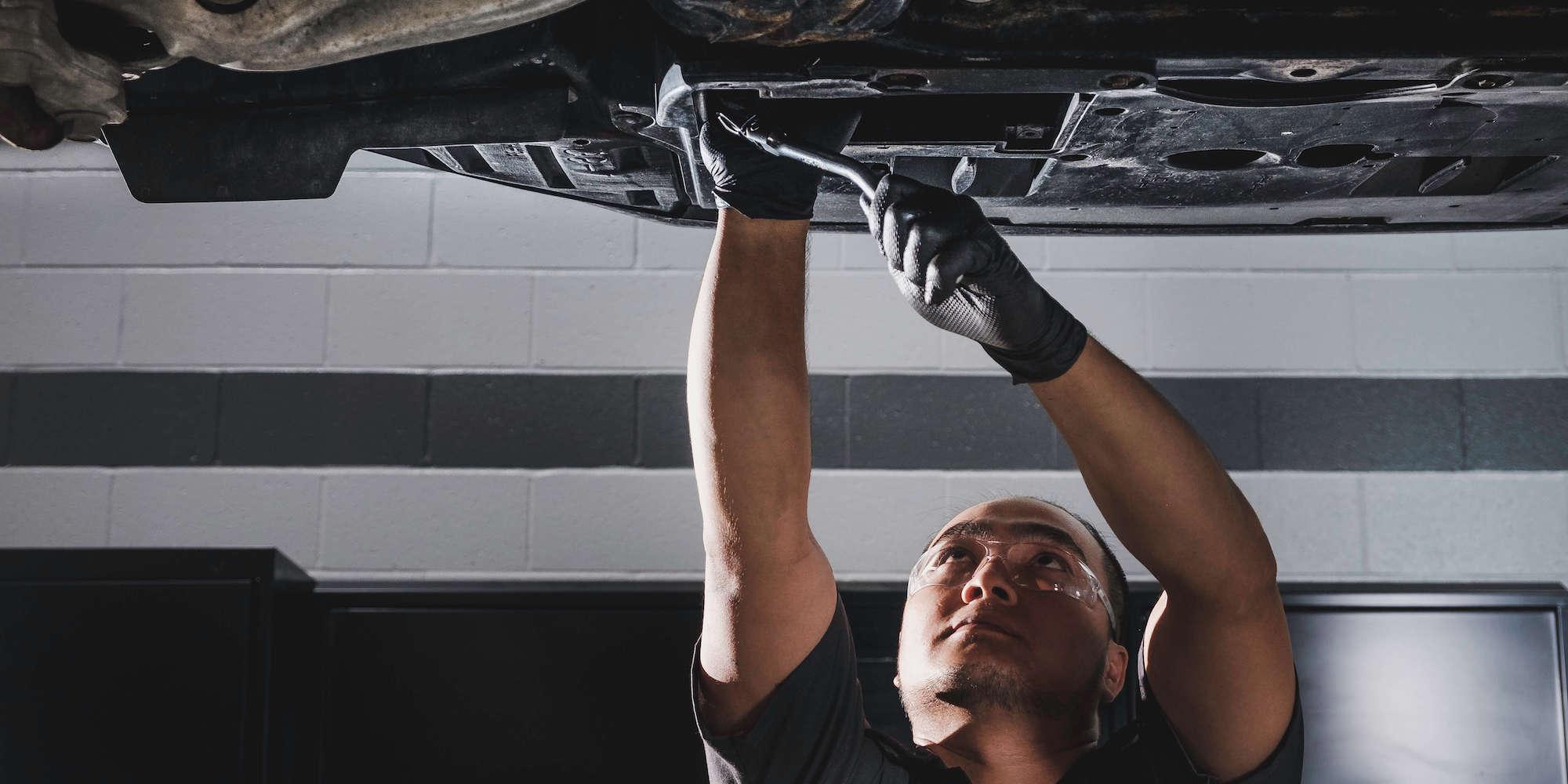 Expert Lexus Technician Changing Oil in Calgary