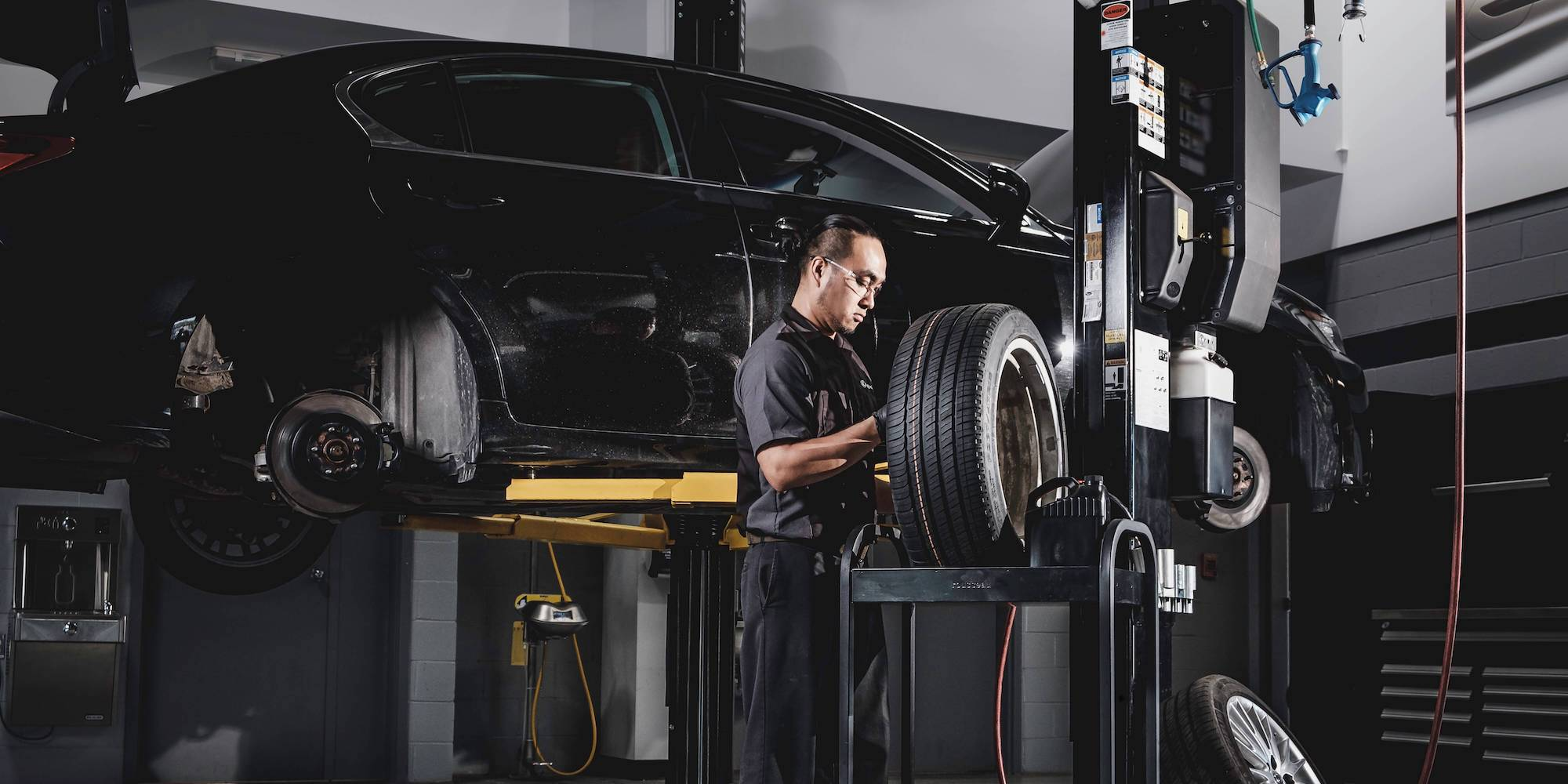 Lexus Technician Working On Tires At A Lexus Service Appointment in Calgary